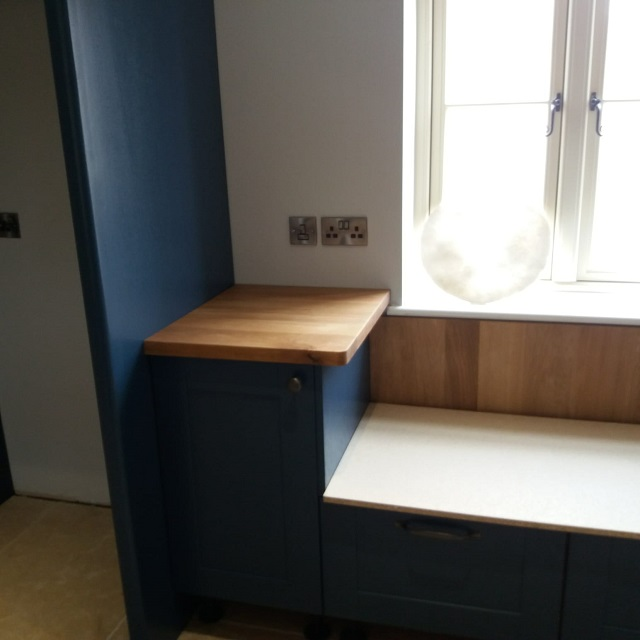 FITTED SOLID OAK WORKTOPS TO PART OF THE KITCHEN