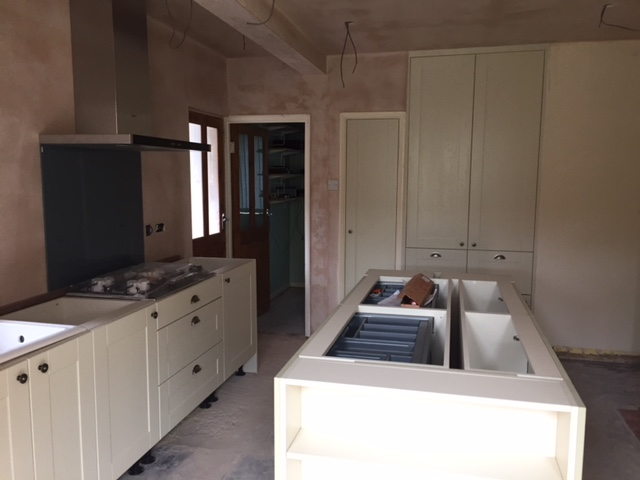Kitchen fitted ready for floor and corian tops