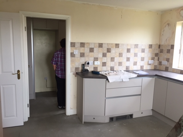 fitted kitchen/tiling ready for floor